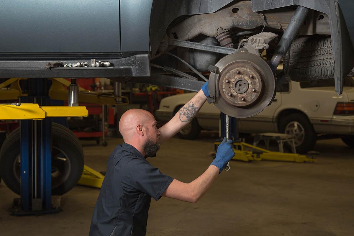 mechanic in shop making a repair