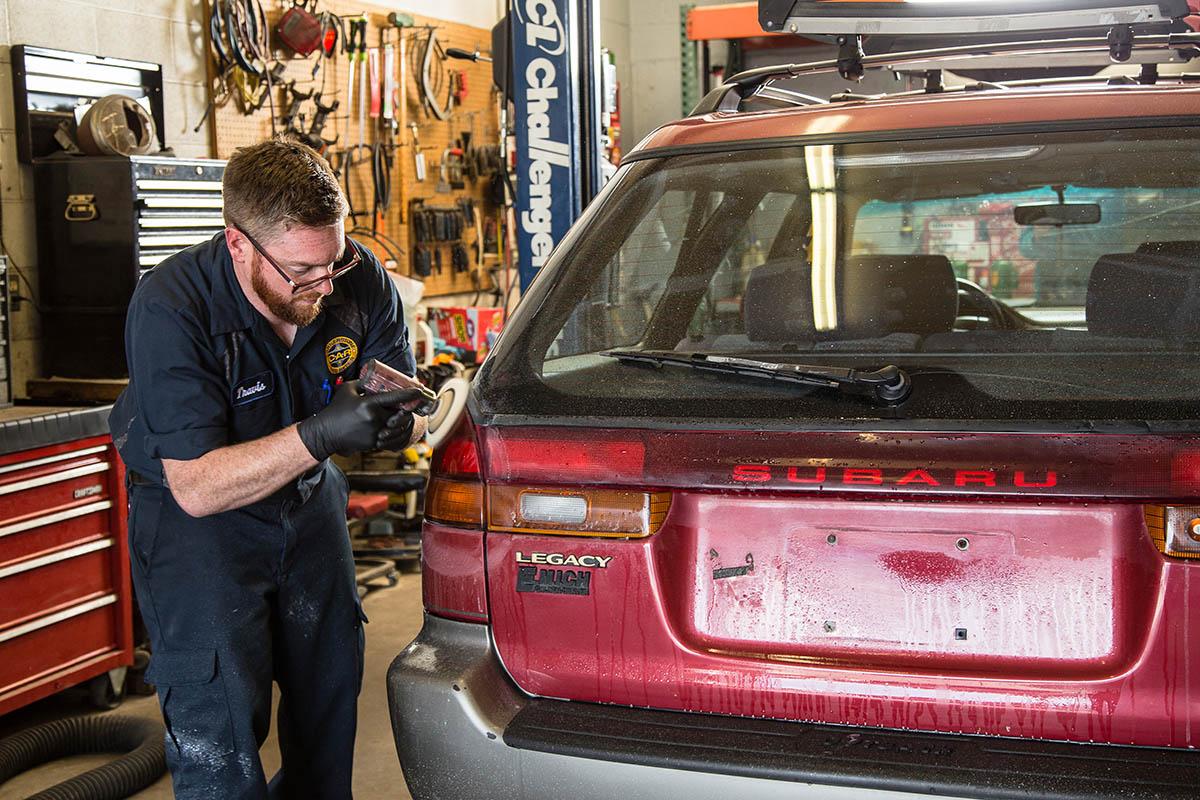Cornerstone mechanic reparing a Subaru
